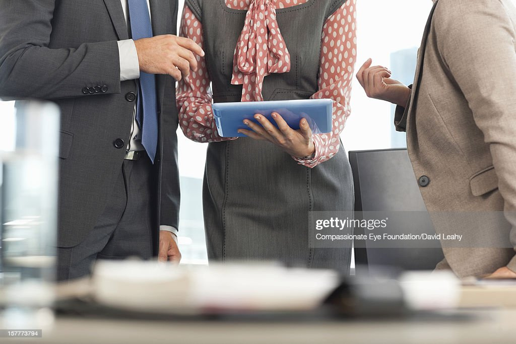 Close up of business people having meeting : Stock Photo