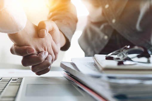Close up of Business people shaking hands, finishing up meeting, business etiquette, congratulation, merger and acquisition concept 866149824