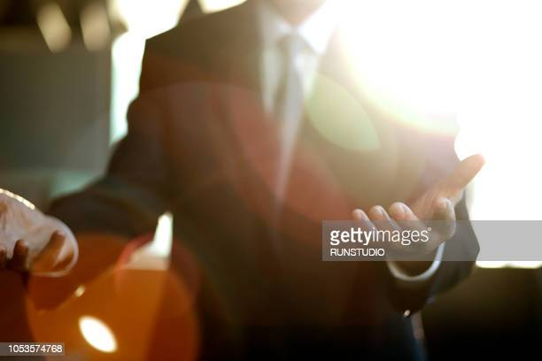 close up of businessman extending hands - gesturing stock pictures, royalty-free photos & images