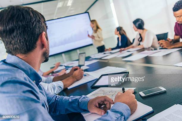Close up of businessman taking notes on a seminar