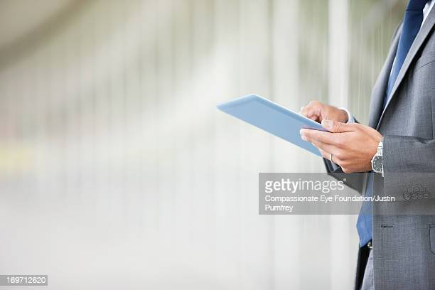 Close up of businessman using digital tablet