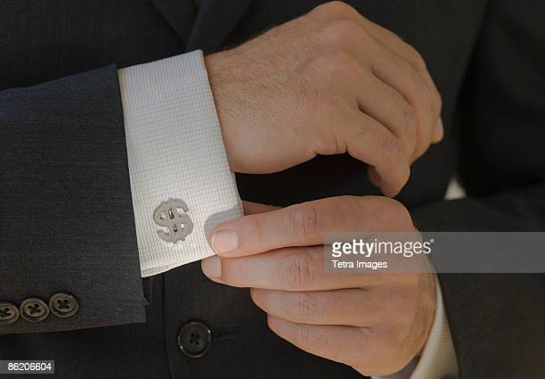 Close up of businessman wearing dollar sign cuff link
