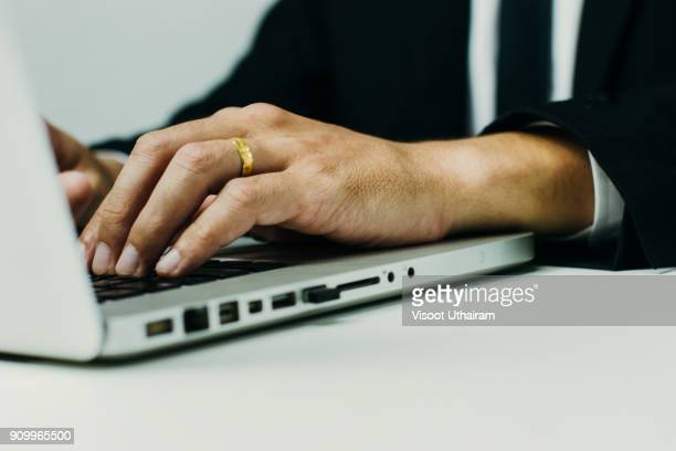 Close up of businessman working on laptop.