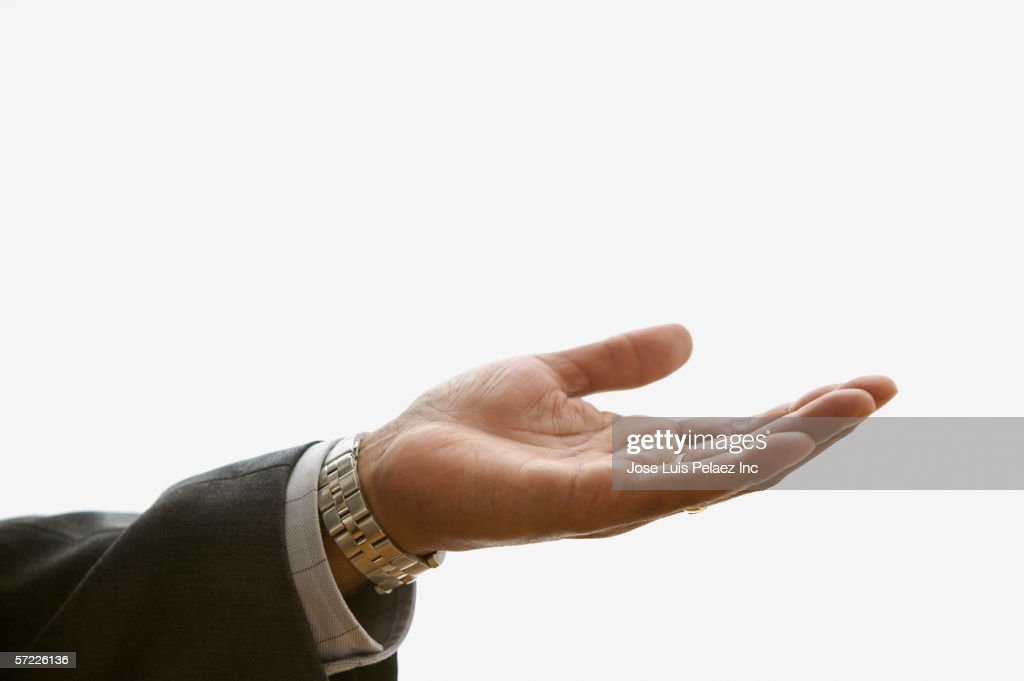 Close up of businessman's hand extended palm up : Stock Photo