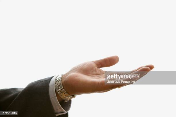 close up of businessman's hand extended palm up - long sleeved stock pictures, royalty-free photos & images