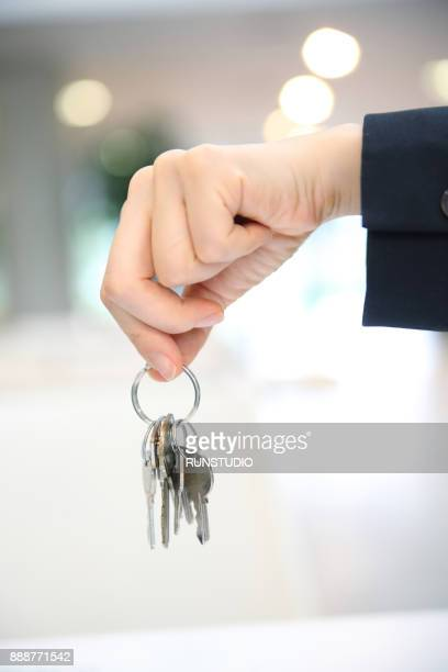 Close up of businesswoman holding keys