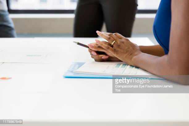 """close up of businesswoman in meeting - """"compassionate eye"""" stock pictures, royalty-free photos & images"""