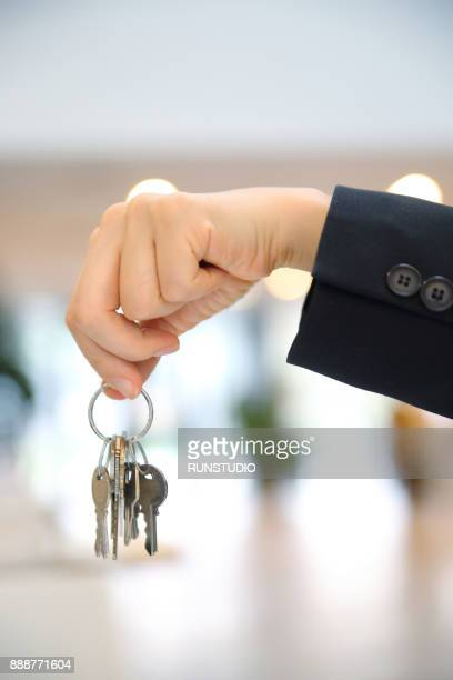 Close up of businesswoman with keys
