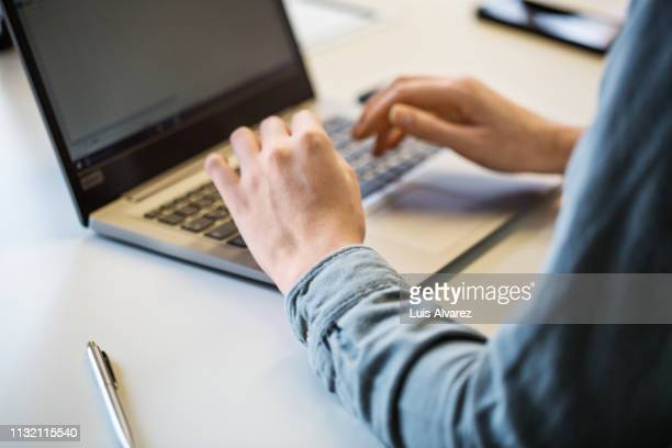 close up of businesswoman working on laptop - laptop stock-fotos und bilder