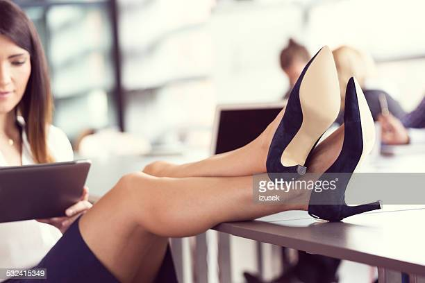 close up of businesswoman's legs wearing highheels - höga klackar bildbanksfoton och bilder
