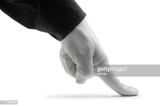 close up of butler using finger to inspect for dirt - commercial cleaning stock photos and pictures