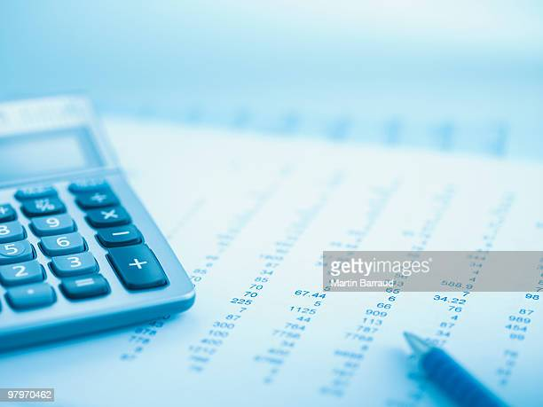 close up of calculator and data - finanzen stock-fotos und bilder