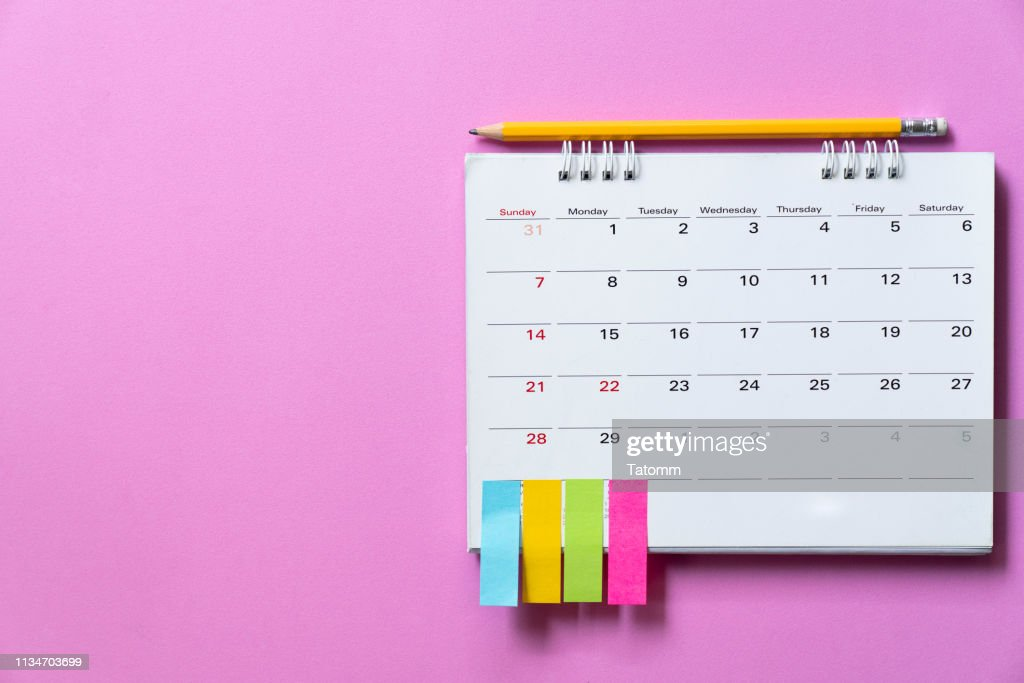 close up of calendar on the pink table background, planning for business meeting or travel planning concept : Stock Photo