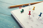 close up of calendar on the table, planning for business meeting or travel planning concept