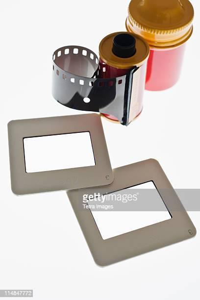 Close up of camera film and slide frames on light box