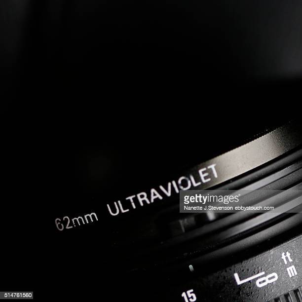 close up of camera lens with a filter - nanette j stevenson stock photos and pictures