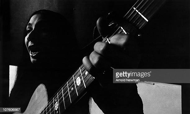 Close up of Canadian musician Buffy SainteMarie as she sings and plays guitar New York New York December 30 1966