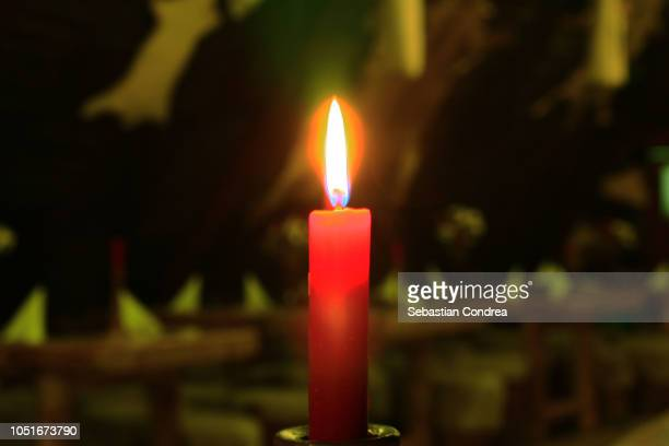 close up of candle burning in church,ceremony, halloween,romania - osterfeuer stock-fotos und bilder
