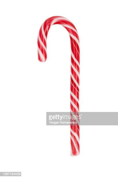 close up of candy cane isolated on white background - candy cane stock pictures, royalty-free photos & images