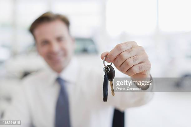 Close up of car salesman holding keys