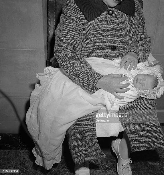 A close up of Caroline Bouvier Kennedy daughter of Senator and Mrs John F Kennedy in her baptismal robes as she was baptized at St Patrick's...