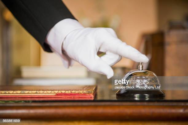close up of caucasian butler ringing bell - white glove stock pictures, royalty-free photos & images
