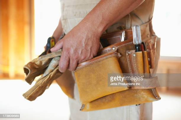 Close up of Caucasian construction worker's tool belt