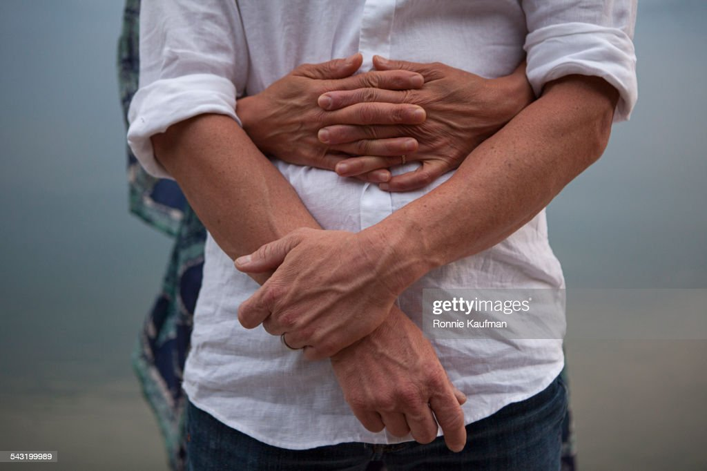 Close up of Caucasian couple hugging : Stock Photo