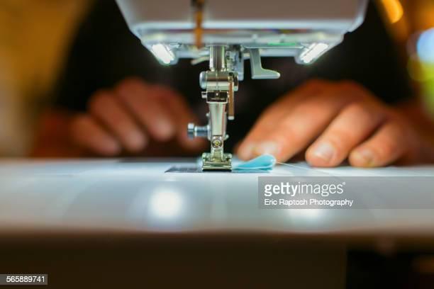 close up of caucasian dressmaker using sewing machine - ミシン ストックフォトと画像