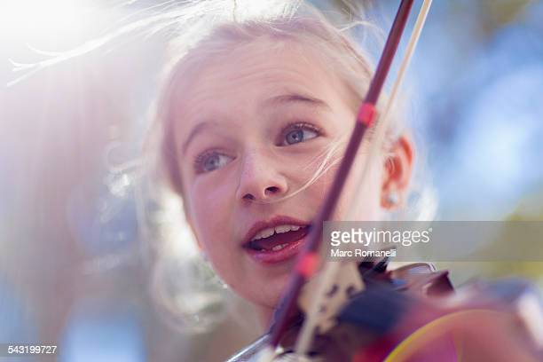 close up of caucasian girl playing violin - violin stock pictures, royalty-free photos & images