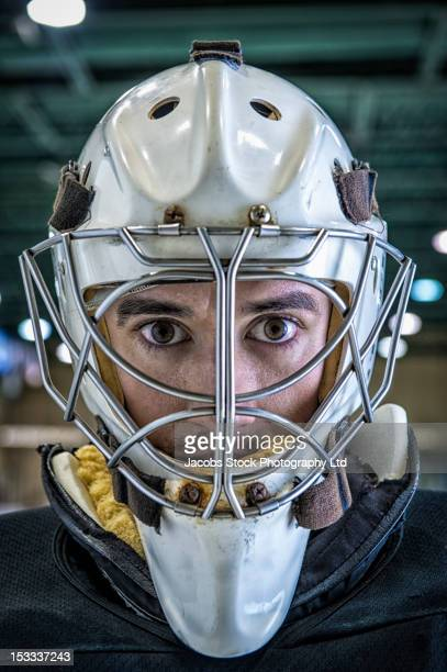 close up of caucasian hockey goalie in mask - ice hockey player stock pictures, royalty-free photos & images
