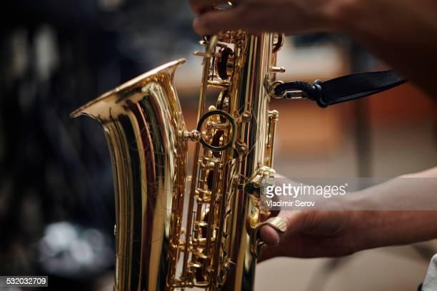 Close up of Caucasian man playing saxophone
