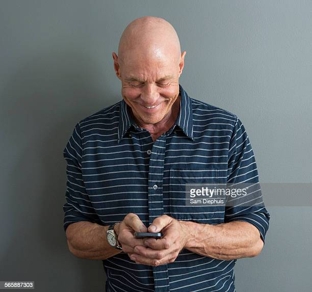 Close up of Caucasian man using cell phone