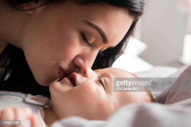 close up of caucasian mother kissing baby son - love emotion stock pictures, royalty-free photos & images