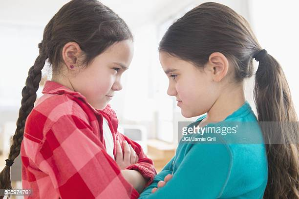 close up of caucasian sisters arguing - rivalry stock pictures, royalty-free photos & images