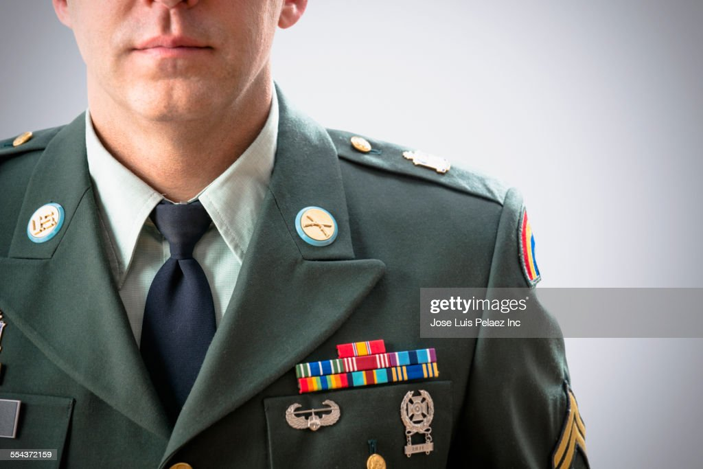 Close up of Caucasian soldier wearing decorated military uniform : Stock Photo