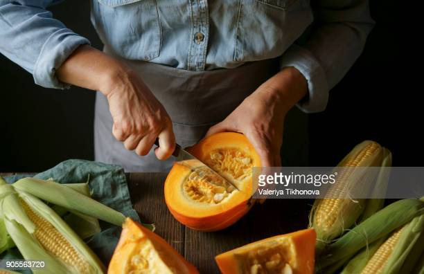 Close up of Caucasian woman cutting squash