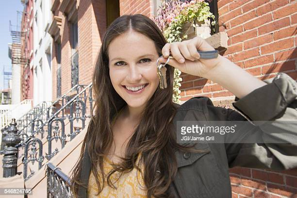 Close up of Caucasian woman holding keys to new house