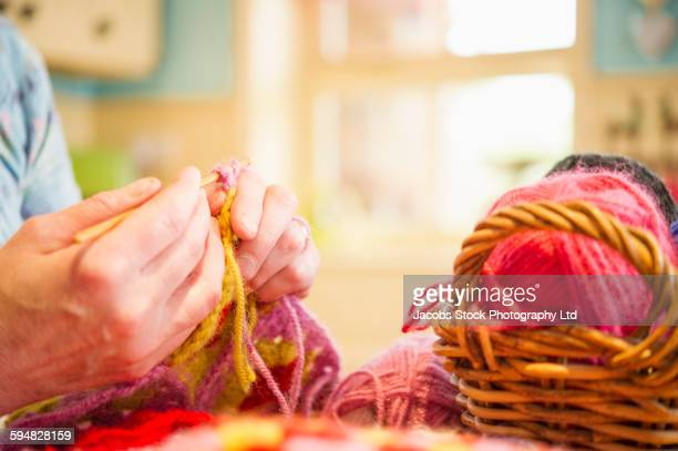 Close up of Caucasian woman knitting