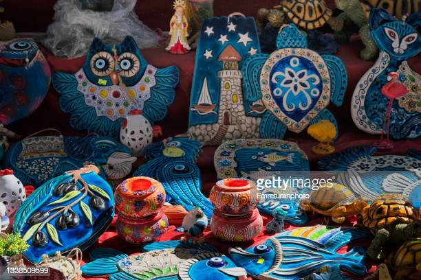 close up of ceramic souvenirs in alacati bazaar. - emreturanphoto stock pictures, royalty-free photos & images