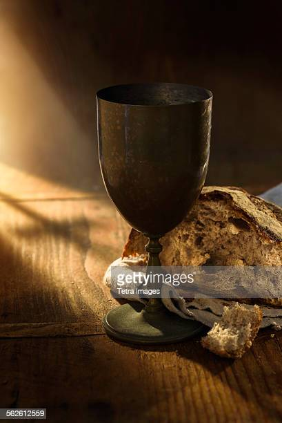 Close up of chalice and bread on table