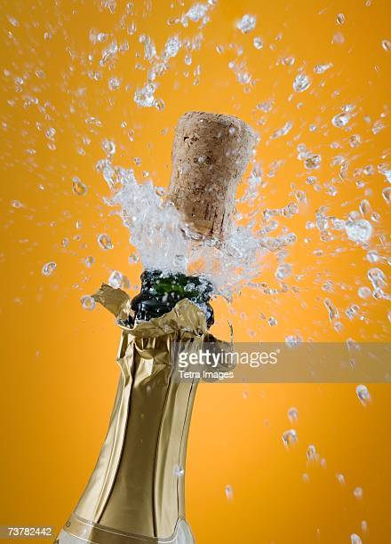 close up of champagne cork popping - champagne cork stock photos and pictures