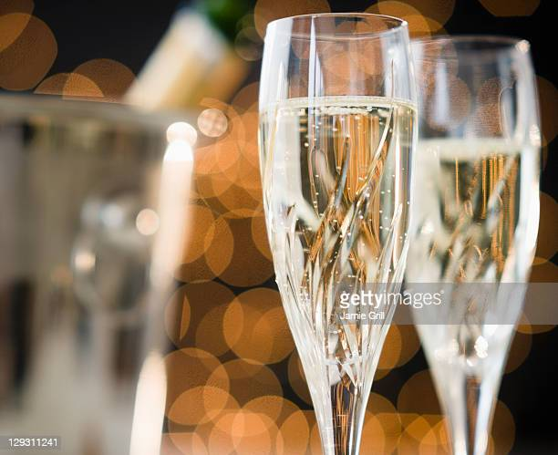 Close up of champagne flutes and ice bucket