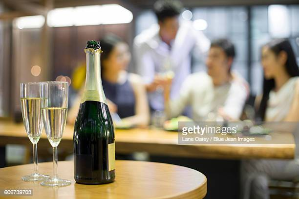 Close up of champagne with friends in background