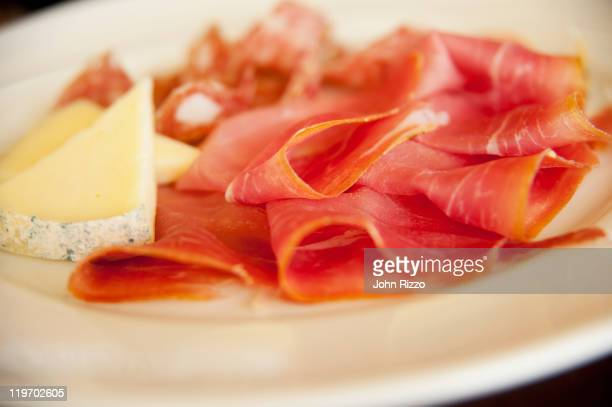 Close up of cheese and  prosciutto