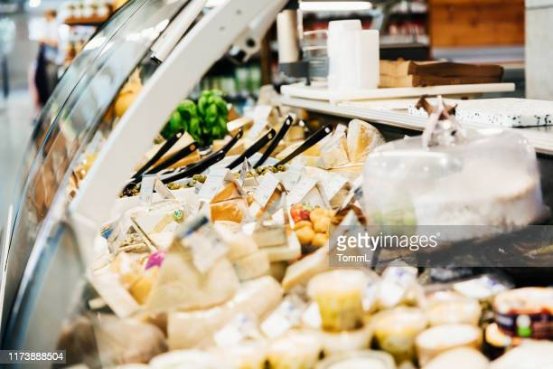 close up of cheese counter at supermarket - delicatessen stock pictures, royalty-free photos & images