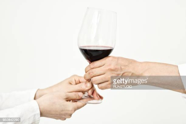 Close up of chef and woman holding wine glass