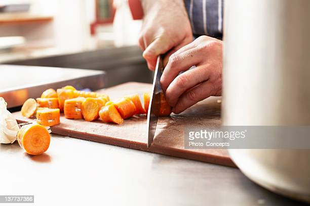 close up of chef chopping carrots - chopping stock pictures, royalty-free photos & images
