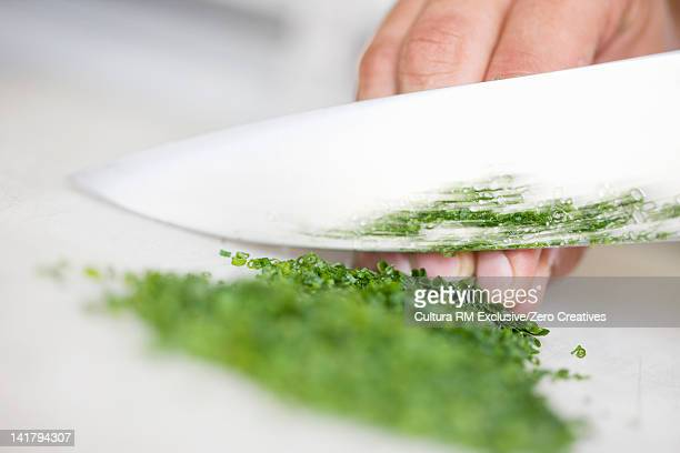 Close up of chef chopping onions