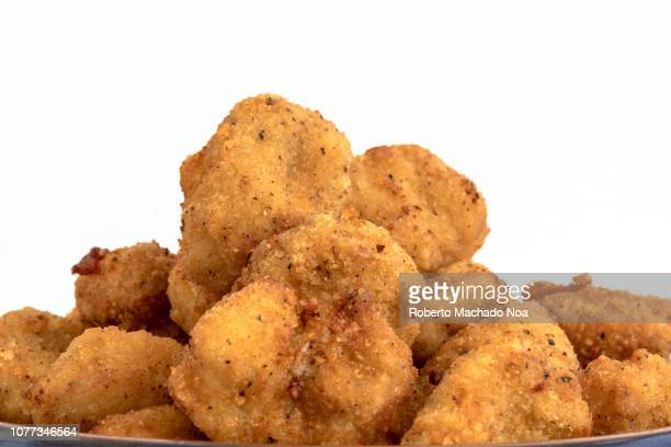 Close up of Chicken Nuggets over a white background Healthy eating or healthy food concept